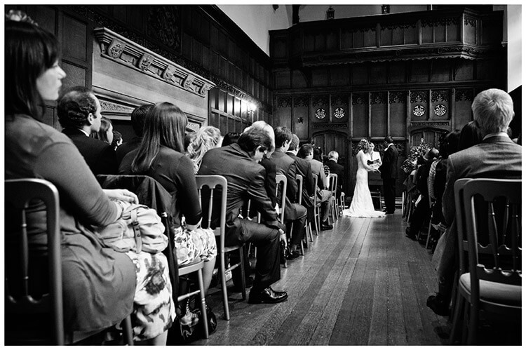 Wedding photography at Hengrave Hall long gallery ceremony