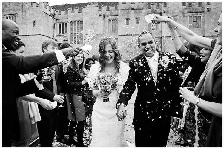 Wedding photography at Hengrave Hall bride groom guests confetti