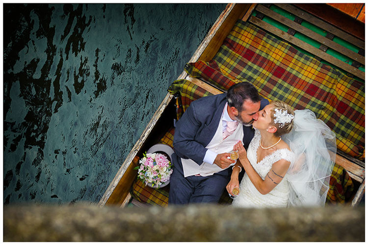 Choosing your perfect wedding photographer bride groom in punt kiss