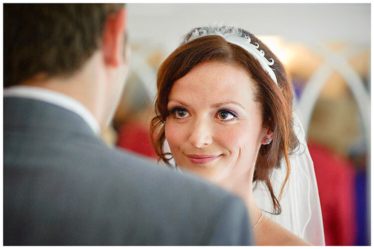 Sheene Mill wedding bride smiling at groom during service