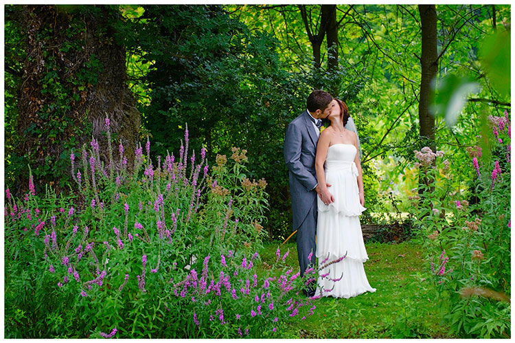Sheene Mill wedding bride groom kiss in gardens