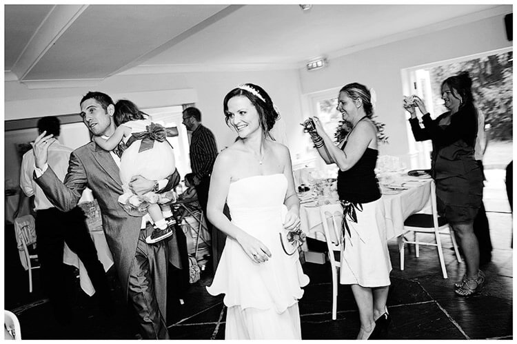 Sheene Mill wedding bride groom enter dining room carrying child guests take photos