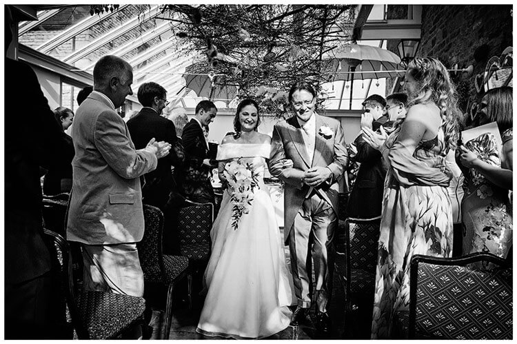 Barnsdale Lodge Hotel wedding couple walking down aisle