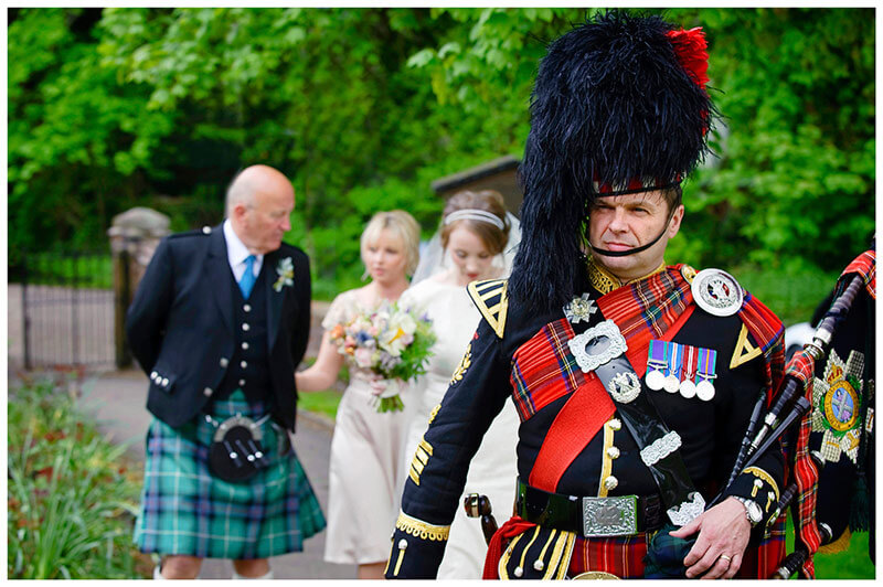 Scottish bag piper leads bridal party to All Saints Church Hartford wedding