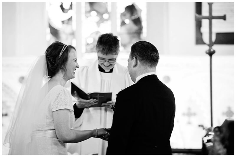 bride laughs during vows