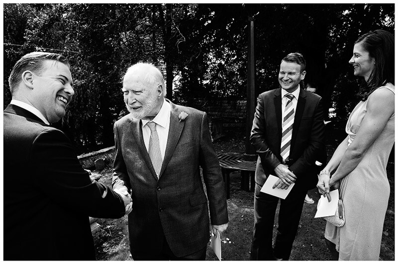 groom greets old chap enthusiastically