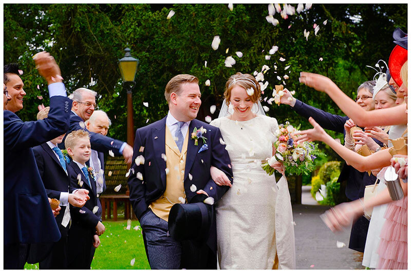 All Saints Church Hartford bride groom smiling confetti