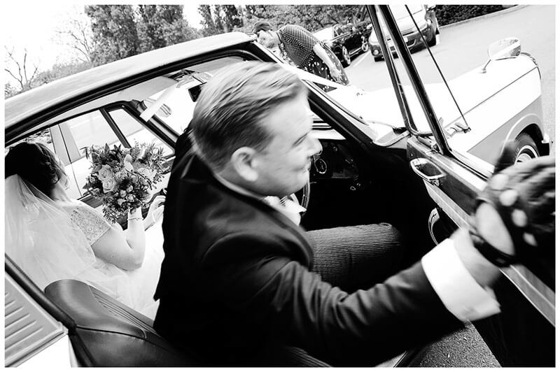 Boutique Hotel wedding Old Bridge Hotel groom getting out of car