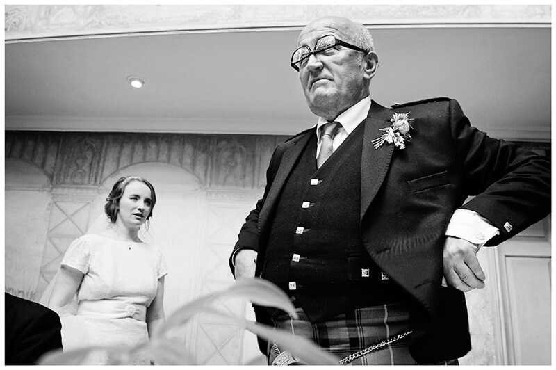 man in kilt glasses upside down gets strange look off bride