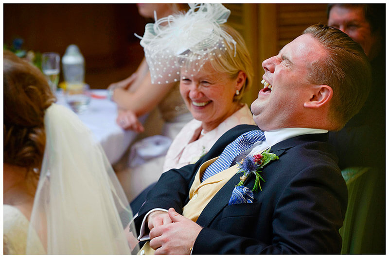 groom laughs during speeches