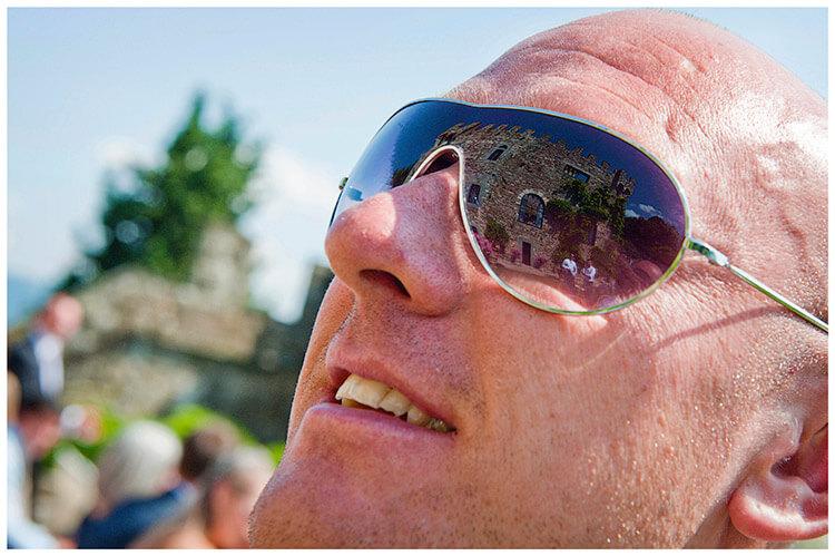 Castello di Vincigliata wedding venue reflected in sunglasses
