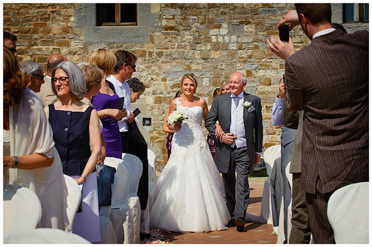 Castello di Vincigliata wedding bride on fathers arm walking down aisle