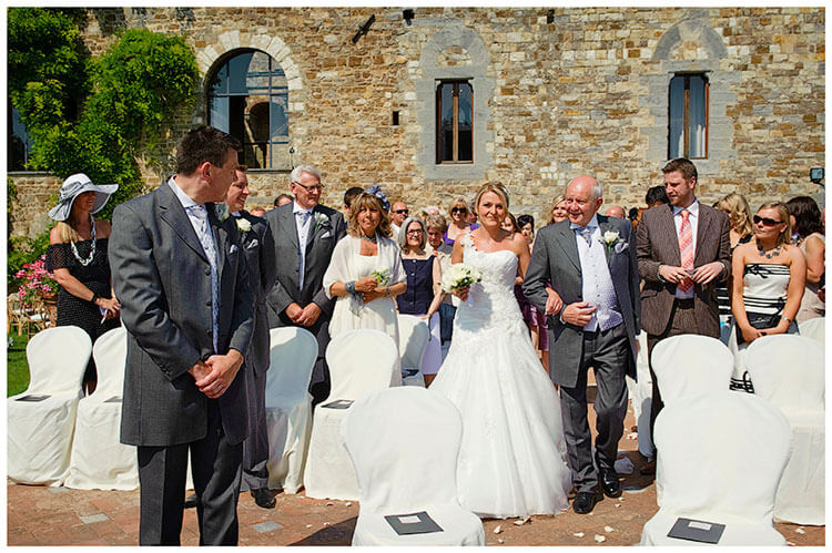 Castello di Vincigliata wedding groom looks at bride as she arrives