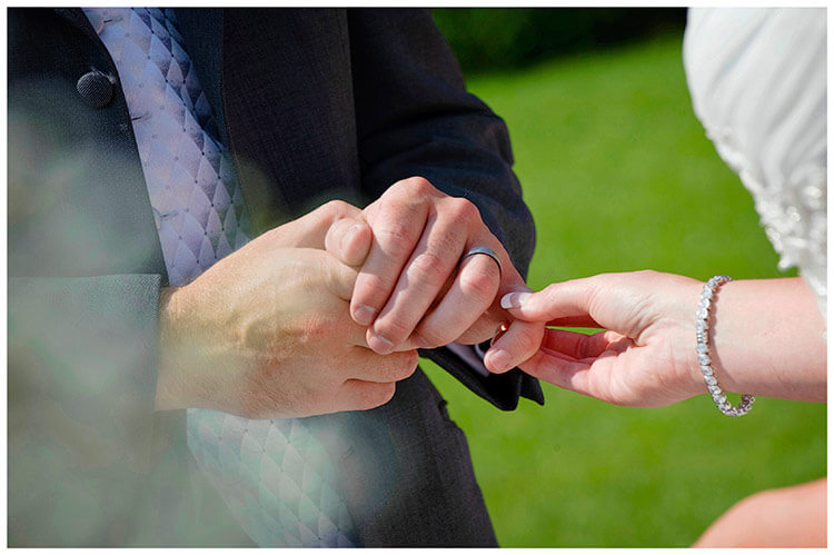 Castello di Vincigliata wedding bride holds grooms little finger during exchange of rings