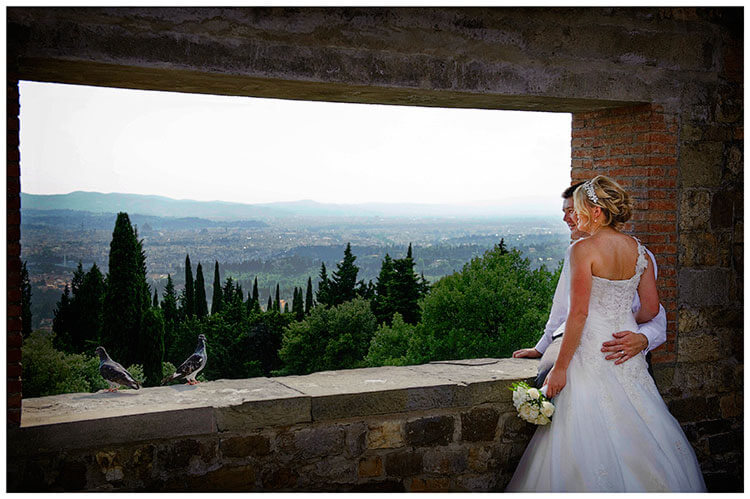 Castello di Vincigliata wedding bride groom two pigeons castle tower opening over looking Florence
