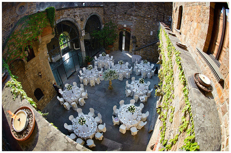 Castello di Vincigliata wedding venue central courtyard set out for dinner