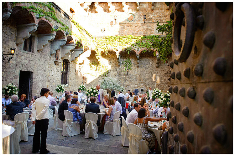 Castello di Vincigliata wedding waitress watching guests enjoy meal