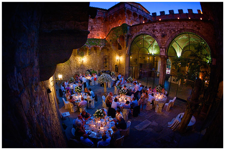 Castello di Vincigliata wedding central court yard guests at tables