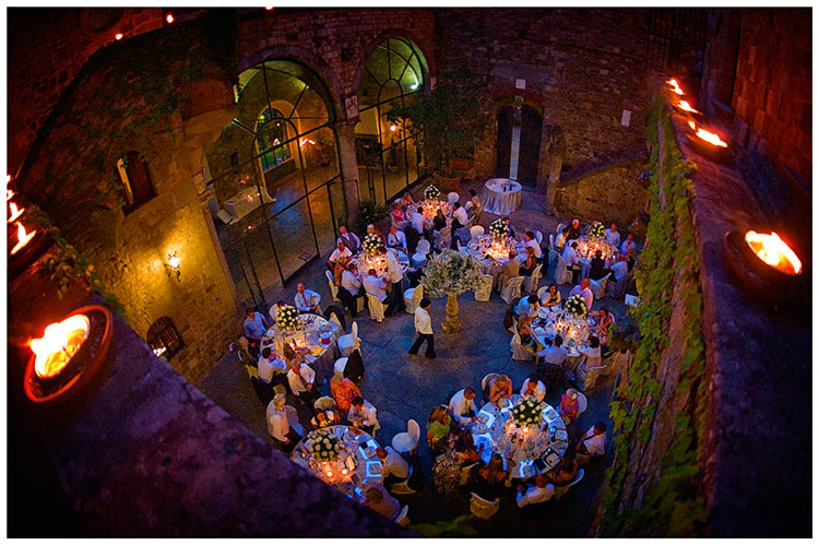 Castello di Vincigliata wedding candle light illuminating guests at tables
