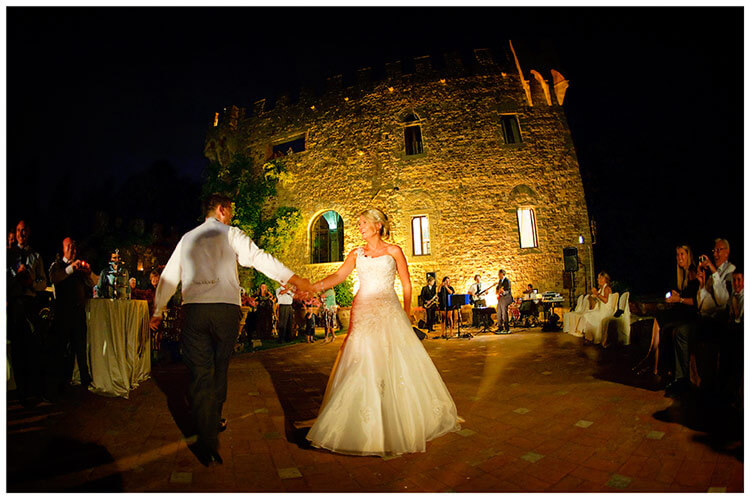 Castello di Vincigliata wedding couple first dance under the stars castle in background