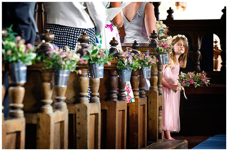 Childerley Hall Summer Wedding flower girls waiting in church pews