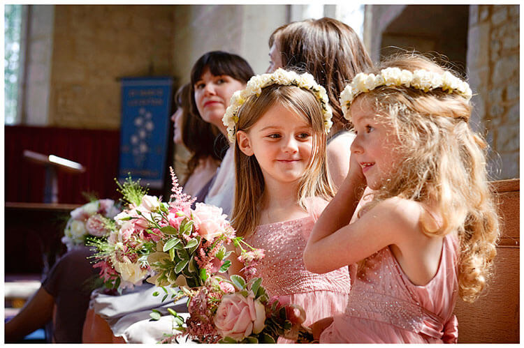 Childerley Hall Summer Wedding smiling flower girls in pink