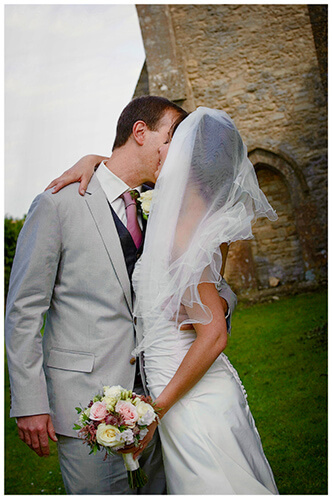 Childerley Hall Summer Wedding couple embrace outside church