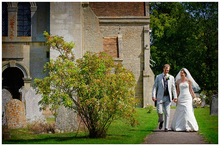 Childerley Hall Summer Wedding couple leave church yard hand in hand