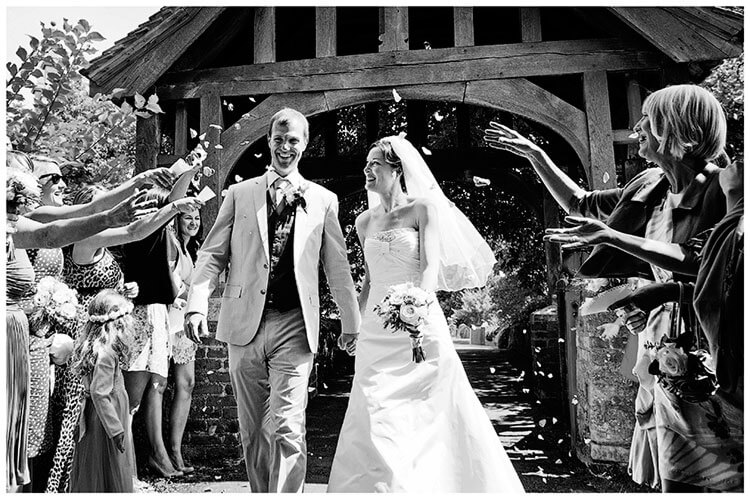 Childerley Hall Summer Wedding confetti smiling couple