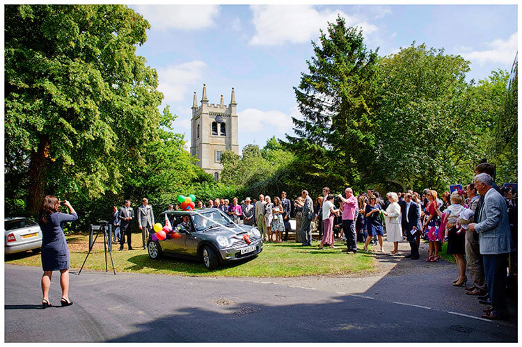 Childerley Hall Summer Wedding guests wave off happy couple