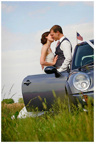 Childerley Hall Summer Wedding bride groom kiss leaning against car