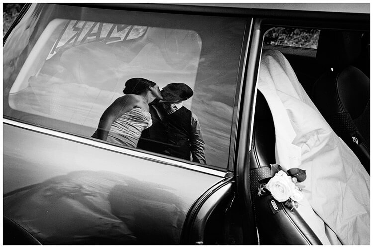 Childerley Hall Summer Wedding reflection in car window bride groom kissing
