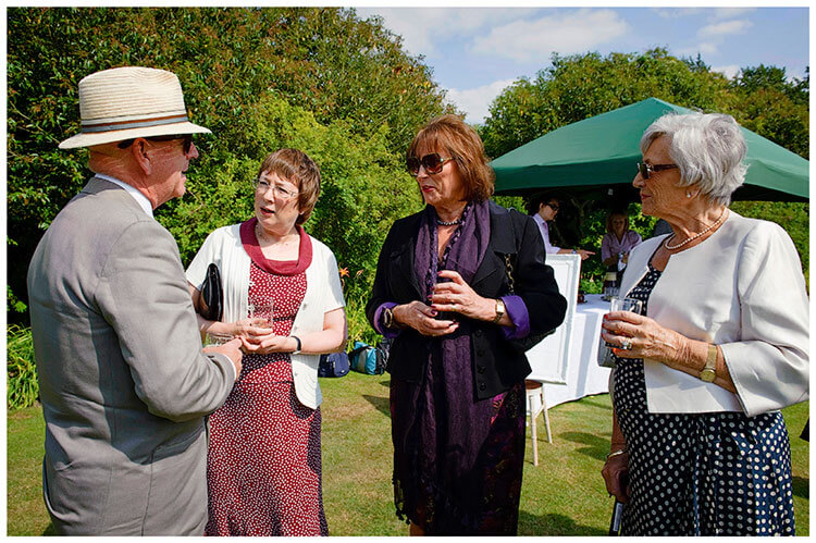 Childerley Hall Summer Wedding guests enjoy drinks on the lawn