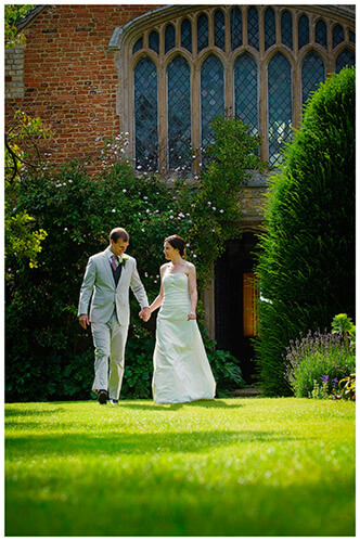 Childerley Hall Summer Wedding bride groom walking in front of chapel on lawn