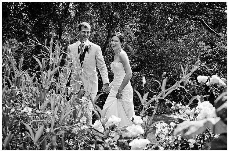 Childerley Hall Summer Wedding bride groom smiling hold hands