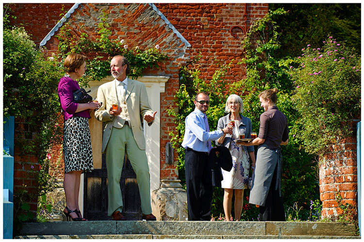 Childerley Hall Summer Wedding guests arrive to drinks