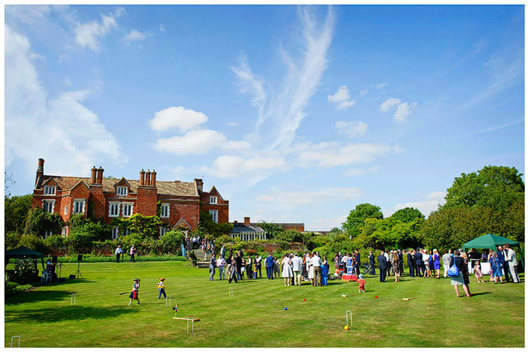 Childerley Hall Summer Wedding venue guests on lawn