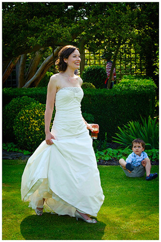 Childerley Hall Summer Wedding bride walking watched by child