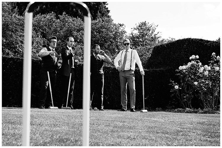 Childerley Hall Summer Wedding guests playing croquet