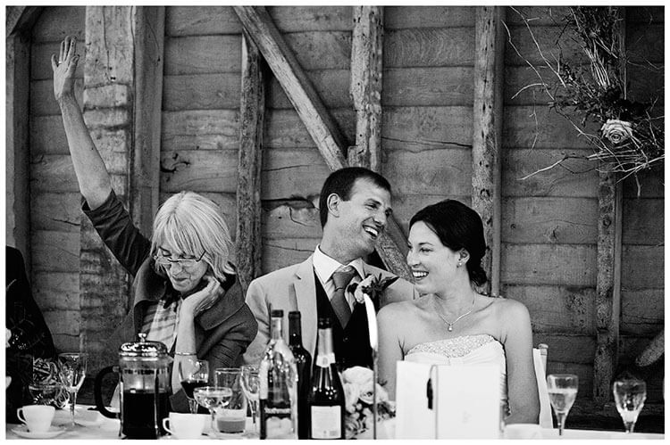 Childerley Hall Summer Wedding brides mother arm in air bride smiling during speeches