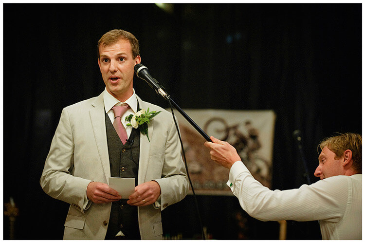 Childerley Hall Summer Wedding grooms speech guest adjusting microphone