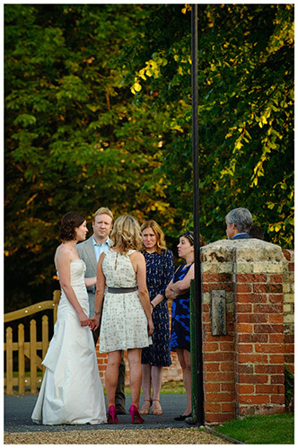 Childerley Hall Summer Wedding guests talking to bride