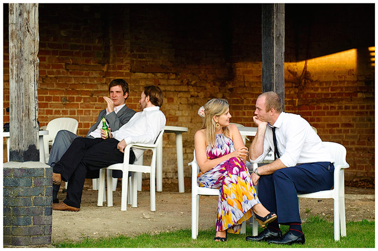 Childerley Hall Summer Wedding couple conversation sat in white chairs