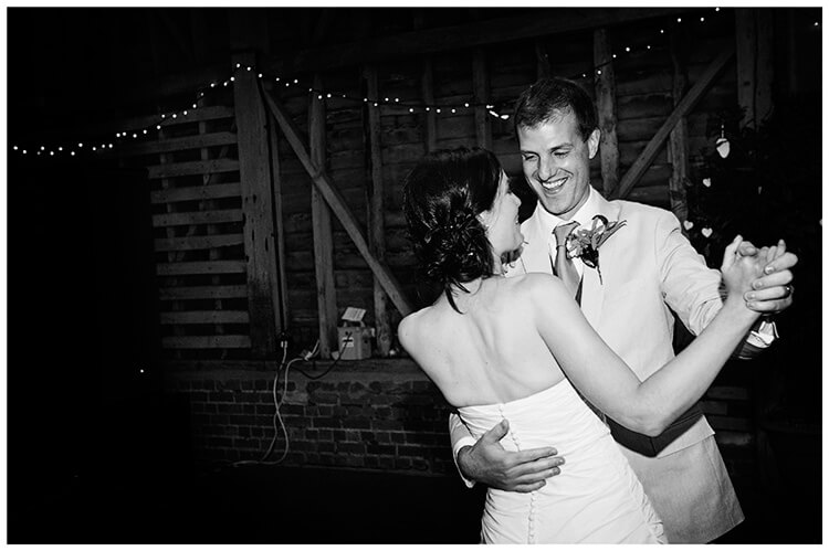Childerley Hall Summer Wedding smiling groom holding bride during first dance