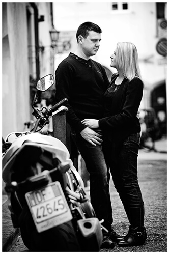 Pre-Wedding Photography in Florence couple embrace near motorbike