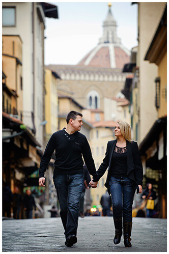 Pre-Wedding Photography in Florence couple holding hands walking the streets of florence
