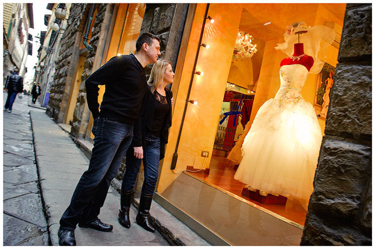 Pre-Wedding Photography in Florence couple stop to admire wedding dress