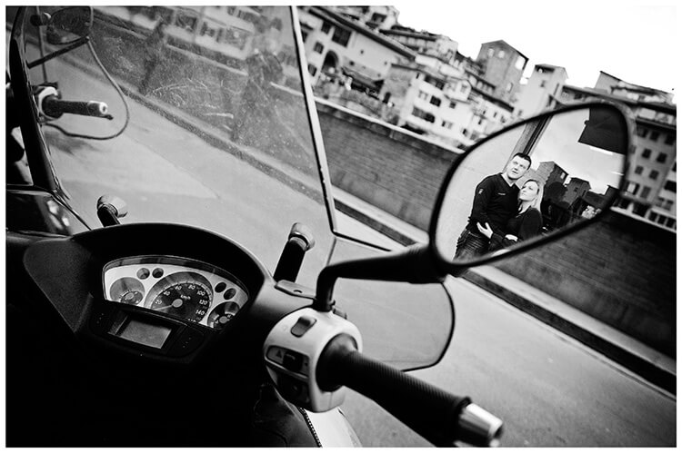 Pre-Wedding Photography in Florence couple embrace reflected in scooter mirror