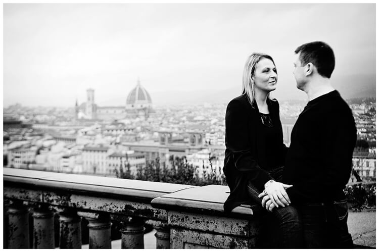 Pre-Wedding Photography in Florence couple share a moment with Duomo and the city behind