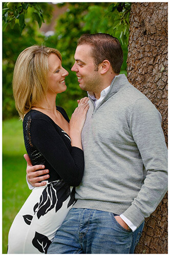 Pre-Wedding Photography shoot in Cambridgeshire loving glance couple leaning against tree